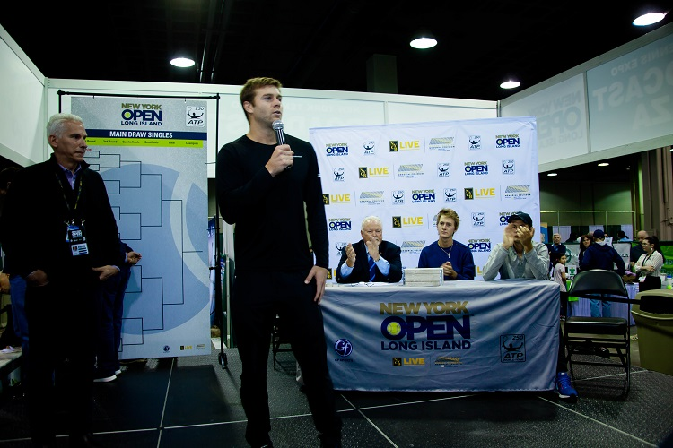 Ryan Harrison talks to the crowd at the 2018 New York Tennis Expo before the draw ceremony for the New York Open began.