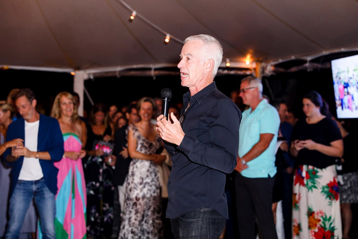 John McEnroe speaks to the crowd during the annual Johnny Mac Tennis Project Pro-Am earlier this summer.