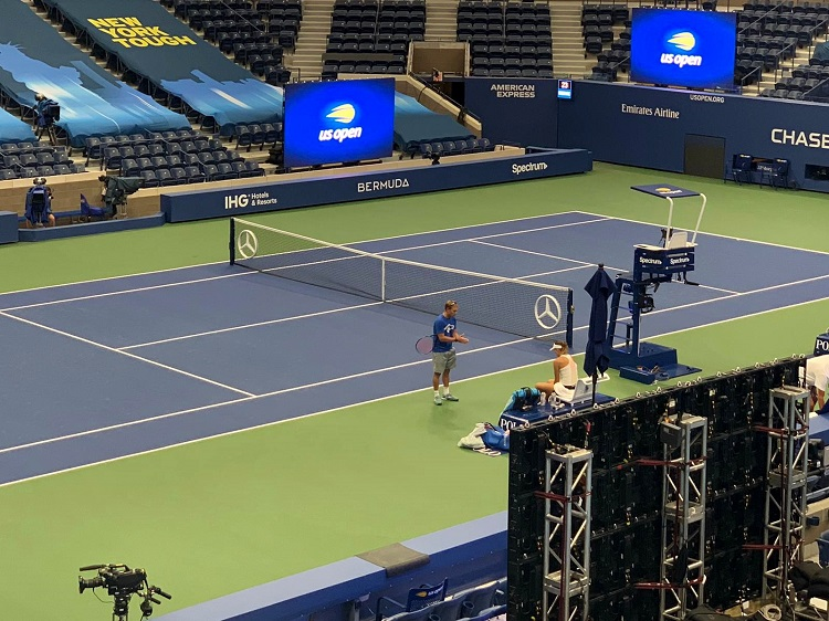 Gellard and Linette go over tactics during a practice session inside Arthur Ashe Stadium.
