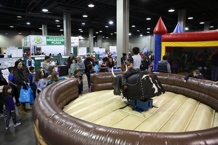 A mechanical bull was one of the new activities to the New York Tennis Expo introduced in 2020.