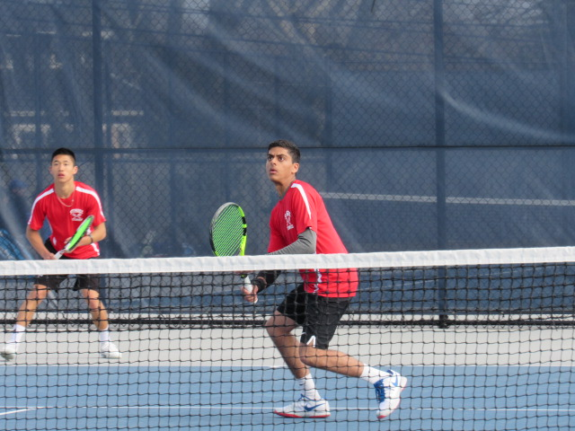 Preet Rajpal(front) and Zach Chan (back) clinched Syosset's55th straight win with their victory at first doubles on Wednesday. (Photo Credit: Jessie Levy)