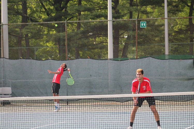 Preet Rajpal serves during the Nassau County Doubles Final on Sunday.