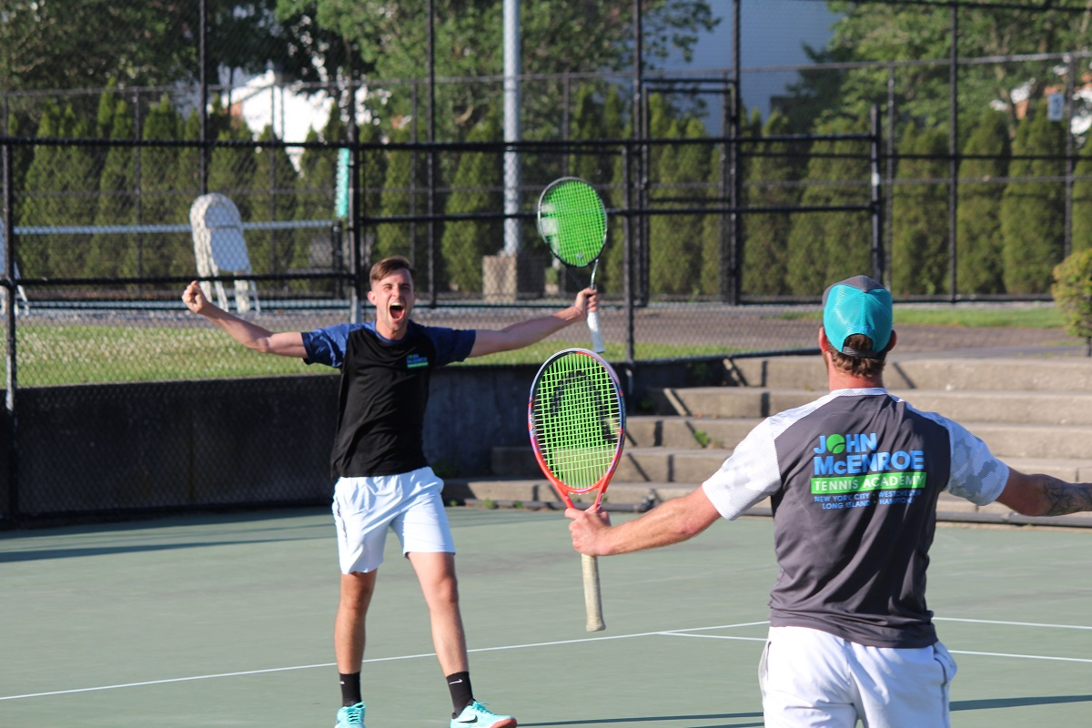 Airam Castellano and Caio Zampieri  celebrate after clinching the Men's Pro title at the 2019 Long Island Tennis Challenge.