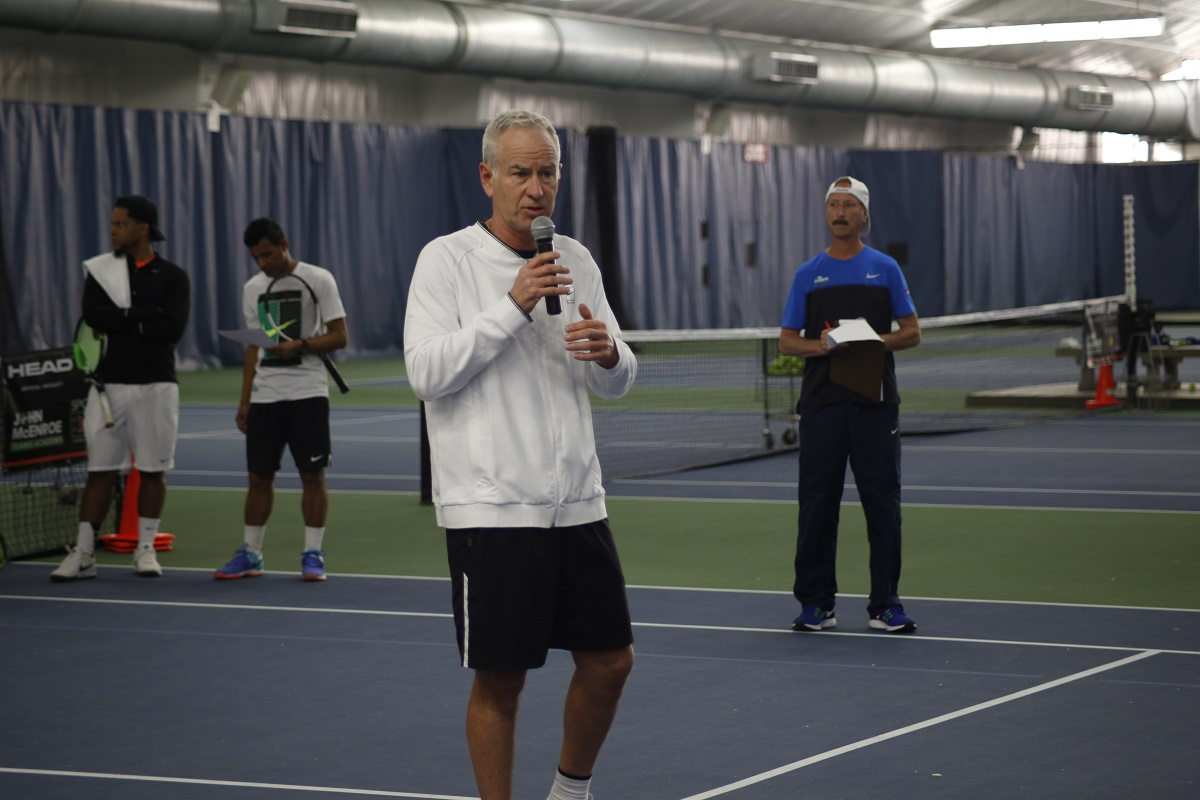 John McEnroe speaks to the players at last year's Scholarship Tryouts. This year's JMTA Long Island scholarship tryouts are set for June 13.