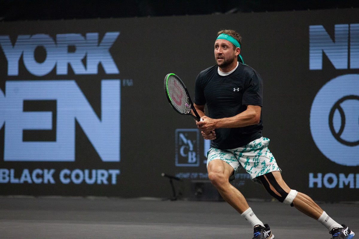 American Tennys Sandgren hits a backhand during his first round match at the 2020 New York Open.