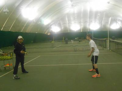 Steve Kaplan demonstrates proper footwork during the coaches clinic at Bethpage Park Tennis Center