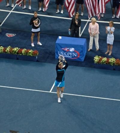 Kim Clijsters raises the 2010 U.S. Open Women's Championship for the second consecutive year after her Saturday night victory over Vera Zvonareva in straight sets 6-2, 6-1