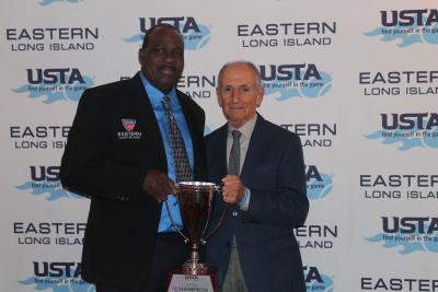 Eddie Fishkind (right), winner of the Vitas Gerulaitis for the Love of Tennis Award is congratulated by USTA Eastern LI Region President Daniel Burgess