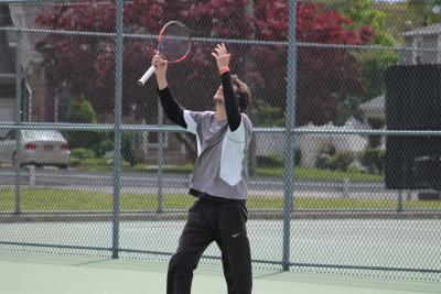 Yuval Solomon celebrates after capturing his second straight Nassau County singles title.