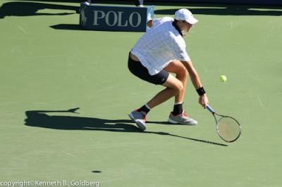 The highest-ranked American in the men's singles draw at the 2012 U.S. Open, John Isner, defeated Belgian Xavier Malisse 6-3, 7-6 (5), 5-7, 7-6(9) in two hours and 56 minutes