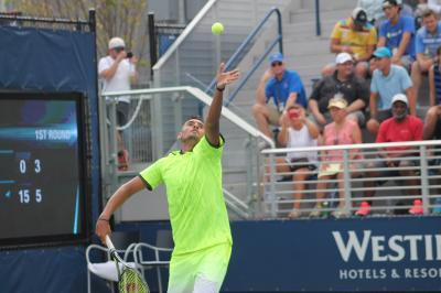 Nick Kyrgios was forced to retire with a hip injury in Queens on Monday.