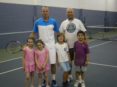 10 & Under Tennis Romanian National Coach Alexandru Pop-Moldovan (standing left) and Doru Murariu (standing right), fitness director from the Tennis Players Fitness Institute, at Syosset Sportime for a 10 & Under Tennis demonstration