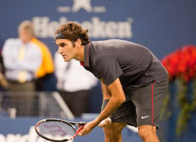 Roger Federer returned to action for the first time in three and a half weeks as he overcame Chinese Taipei's Yen-Hsun Lu and was a 6-3, 7-5 winner at the 2012 Shanghai Rolex Masters
