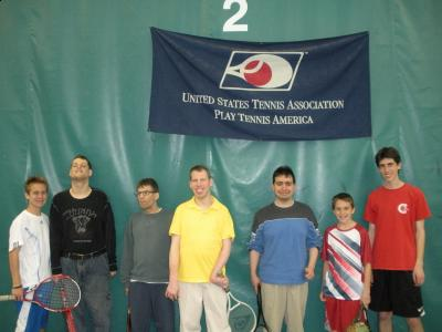 Eric Dietsche (far right) with volunteers and members of the SCORE (Student Caring Offers Recreational Excel-lence) program gather for a photo at the Deer Park Indoor Tennis Club