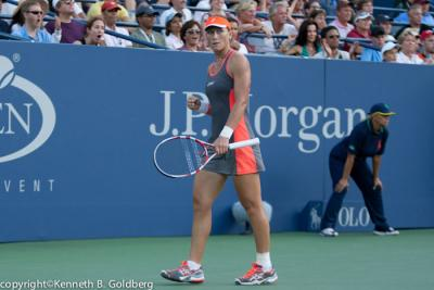 After dropping the first set, Samantha Stosur defeated Virginie Razzano 1-6, 6-2, 6-4 to advance to the quarterfinals of the 2012 HP Open in Japan