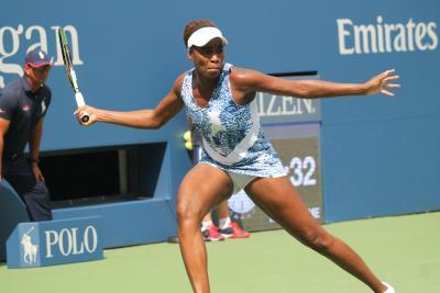 Williams sisters play back-to-back in Ashe at rainy US Open
