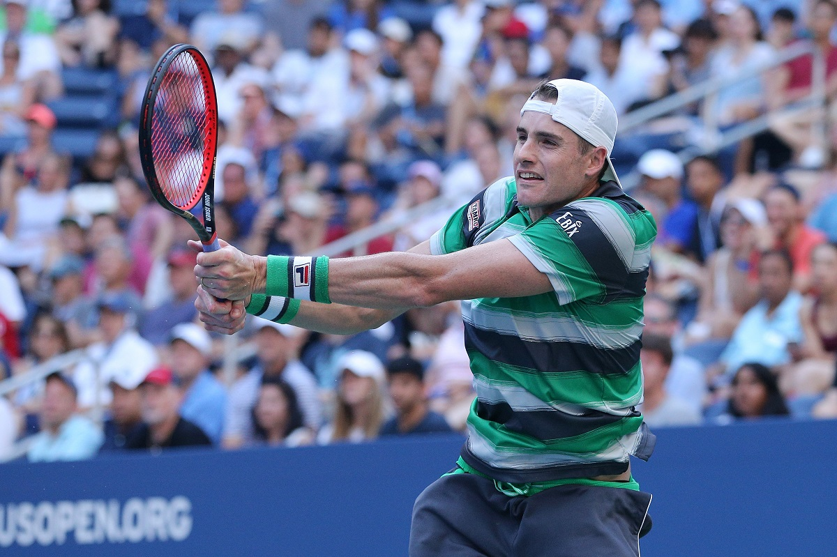 John Isner's is back into the U.S. Open quarterfinals for the first time in seven years after he outlasted 25th seeded Canadian Milos Raonic 3-6, 6-3, 6-4, 3-6, 6-2 in three hours and eight minutes on Sunday.