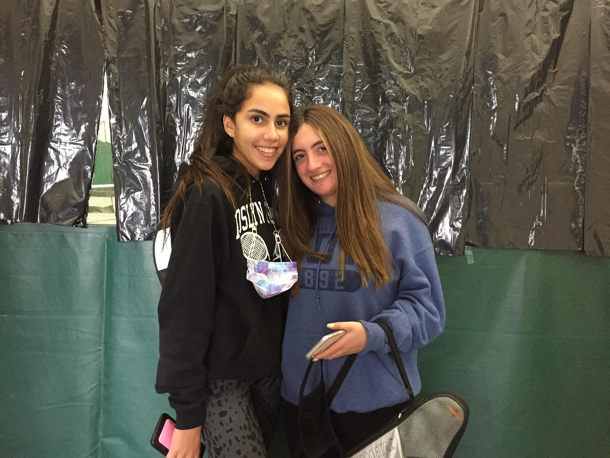 Amanda Lerner (pictured right) with Roslyn teammate Emily Wivietsky (pictured left) at a high school charity event last year.