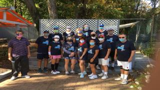 Members of the 65 & Over Mixed Doubles League in their custom USTA shirts