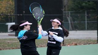 Each year, the Commack girls' tennis team hosts a fundraiser to raise money for the Breast Cancer Research Fund.