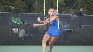 Katie Kors hits a running forehand during her and Phoebe Levitsky's victory at second doubles for Port Washington.