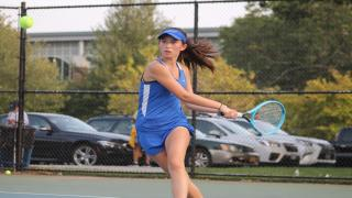 Dasha Perfiliev hits an approach shot during her win at first singles as Port Washington defeated Roslyn on Monday.