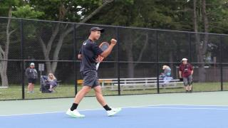 Commack's Eddie Liao celebrates winning a big point during the Suffolk County Singles Championship.