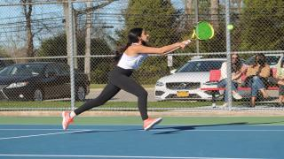 Liv Tiegerman hits a volley during her and Alex Ho's comeback win at first doubles.