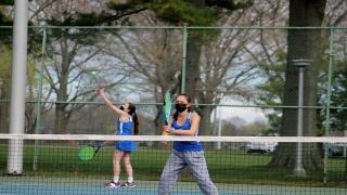 Ellie Ross serves during the Nassau County Doubles Championship.