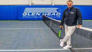 Phil Barres stands on court at Glen Head Racquet & Fitness.