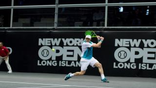 Former Wimbledon semifinalist Sam Querrey booked his spot in the second round of this year's Championships with an upset over recent French Open finalist and fifth-seed Dominic Thiem, downing the Austrian 6-7(4), 7-6(1), 6-3, 6-0.