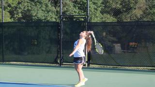 Sarah Faber serves during her win at third singles on Wednesday.