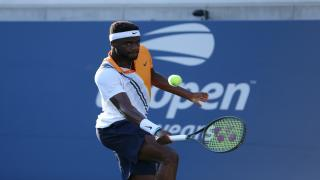 Frances Tiafoe powered his way to a straight-sets win in the opening round of the Australian Open on Monday.