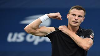 Marton Fucsovics hung on to defeat former champion Stan Wawrinka at the Australian Open on Wednesday.