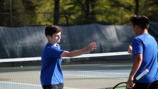 Mikey Weitz celebrates a point with partner Adrian Tsui. The duo won the Nassau County doubles title over the weekend.