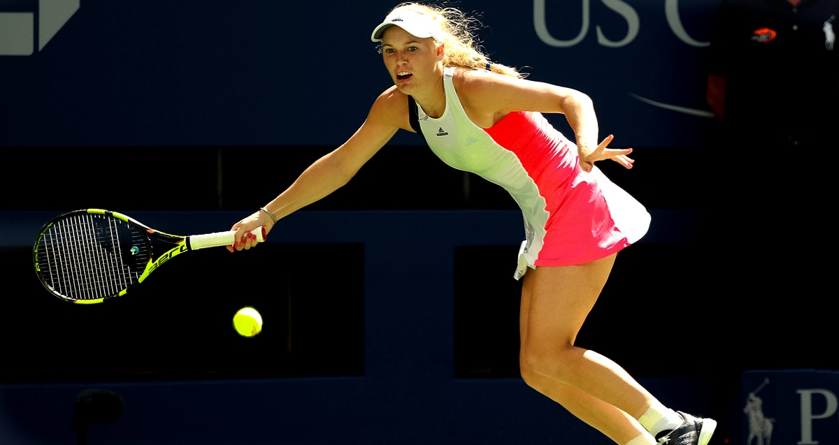 Two-time finalist Caroline Wozniacki powered her way into the second round of the U.S. Open with a convincing 6-3, 6-2 victory over former champion Samantha Stosur inside Arthur Ashe Stadium Tuesday afternoon